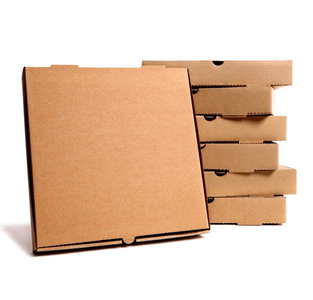 Stack of plain brown pizza boxes with one front facing box for display or advertising.  Isolated on white background.  Copy space.